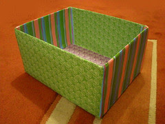 I covered a small cardboard box with scrapbooking papers