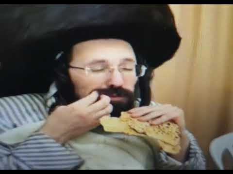 Mezbiz Rabbi Eating Matzos on Pesach Sheni