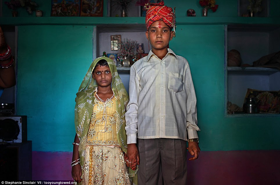 New family: Maya, 8, and Kishore, 13, pose for a wedding photo inside their new home the day after the Hindu holy day of Akshaya Tritiya, or Akha Teej, in Rajasthan, India