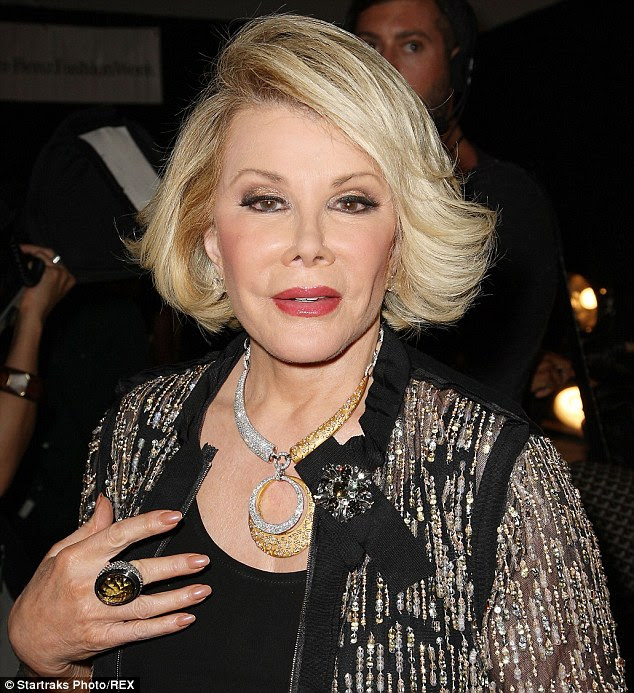 Star: Joan Rivers (pictured here in 2012 at the New York Fashion Week) has been a fixture of American life for more than 50 years and she is celebrated for her acerbic wit