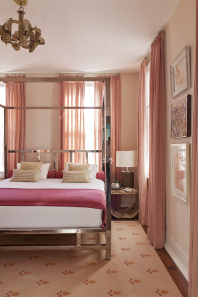Bedroom - A four-poster chrome bed surrounded by shades of pink and peach