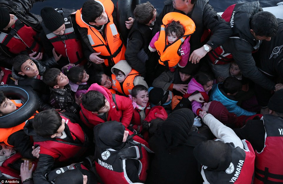 Syrian refugees, who tried to go to Greek island of Chios, are seen in a boat after they were caught by Turkish Coast Guard
