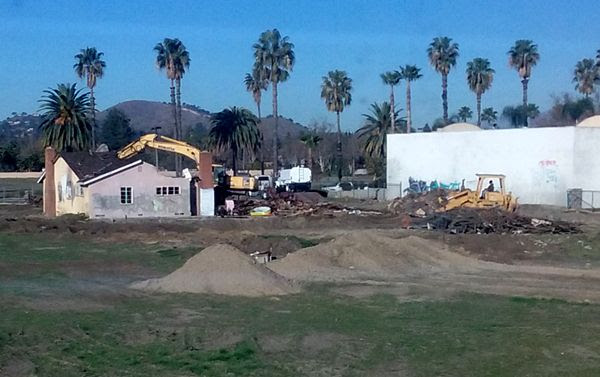 A demolition crew begins tearing down an old abandoned house on a vacant dirt lot behind my home in Pomona, CA...on January 26, 2018.