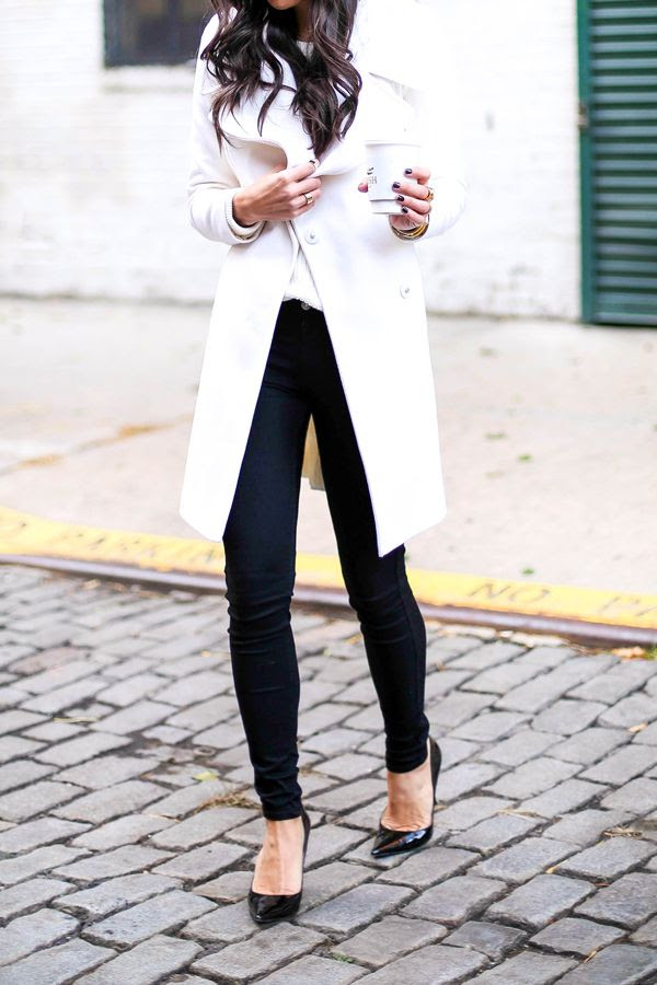 Black skinny jeans and black pumps is a classy way to stay stylish at the office.