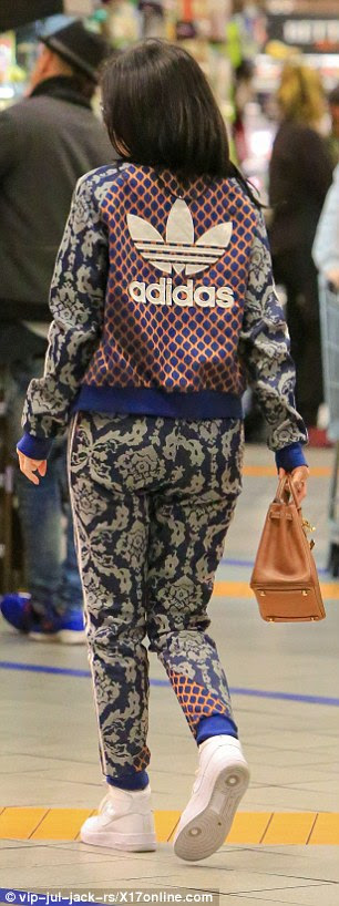 Unique style:Kylie once again showed off her edgy style credentials in the two-piece shell suit which was adorned with a clash of two retro prints