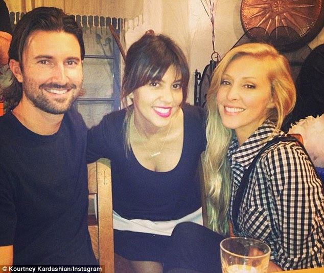 Extended family: Kourtney with her stepbrother Brandon Jenner and his wife Leah