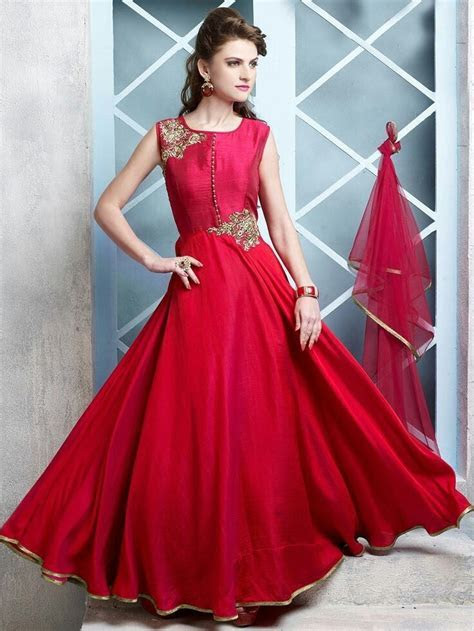Long designer gown with beautiful red dupatta.   Designer