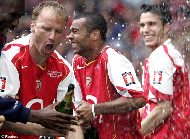 Winning mentality: Bergkamp (second left) celebrates the 2005 FA Cup win - Arsenal's last trophy