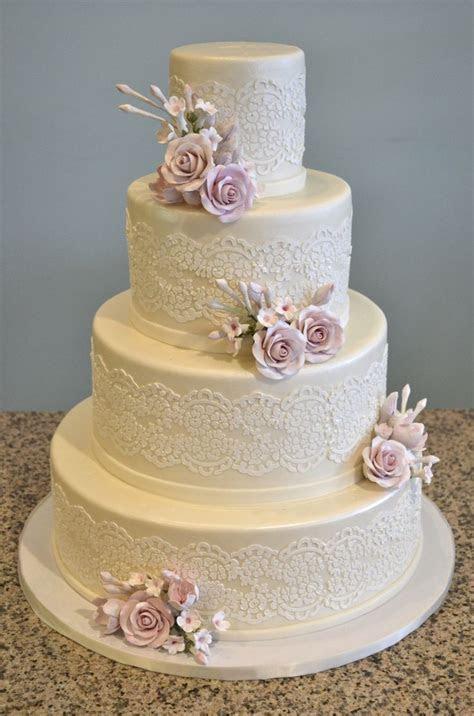 Lace patterned and sugar rose wedding cake   Fondant