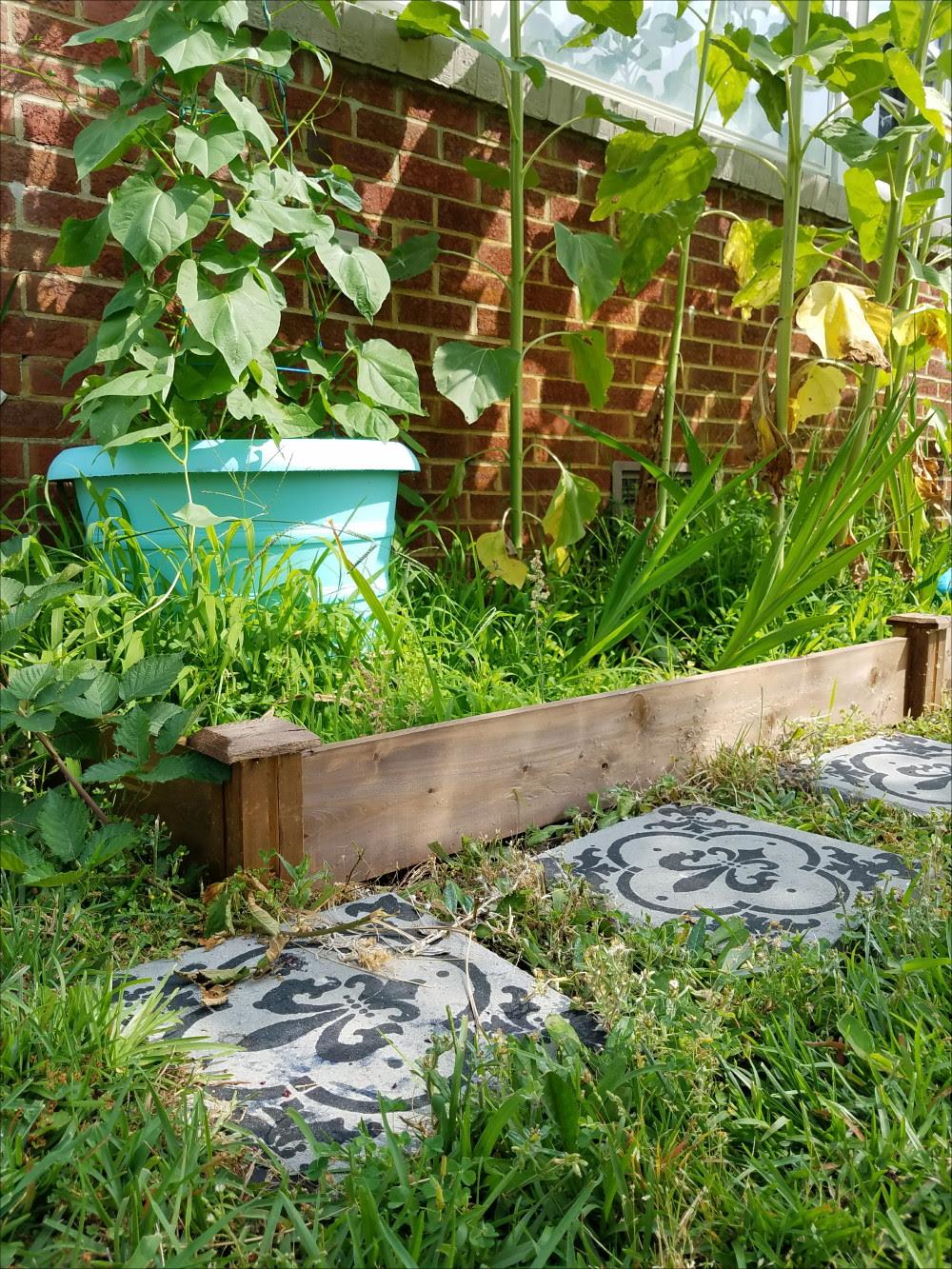 Encaustic tile look alike yard pavers and customized raised garden bed kit. Aqua yard details - @adesignerathome