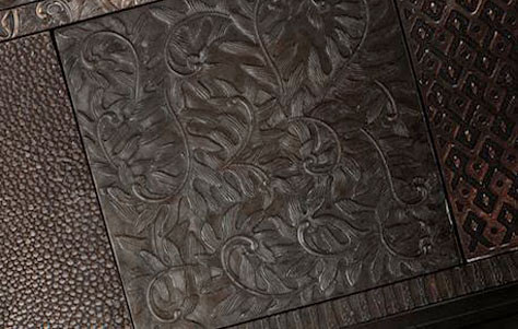 eco-friendly tiles, metal tiles, patterned metal tiles, pos-consumer recycled products, pos-consumer recycled tiles, sculptural cast metal tiling