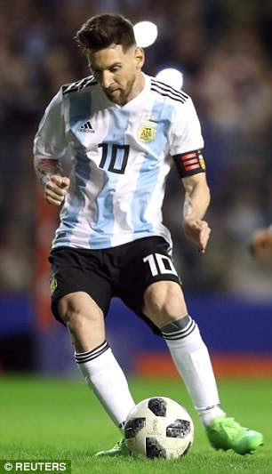 Lionel Messi and Manuel Lanzini wear Argentina's strips to be used in Russia this summer