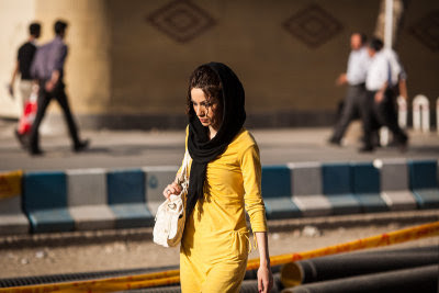Woman walking, South Tehran