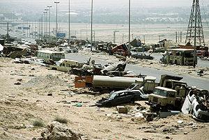 Demolished vehicles line Highway 80 on 18 Apr 1991.jpg