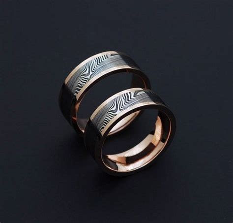 Genuine stainless Damascus Steel and Rose Gold Wedding