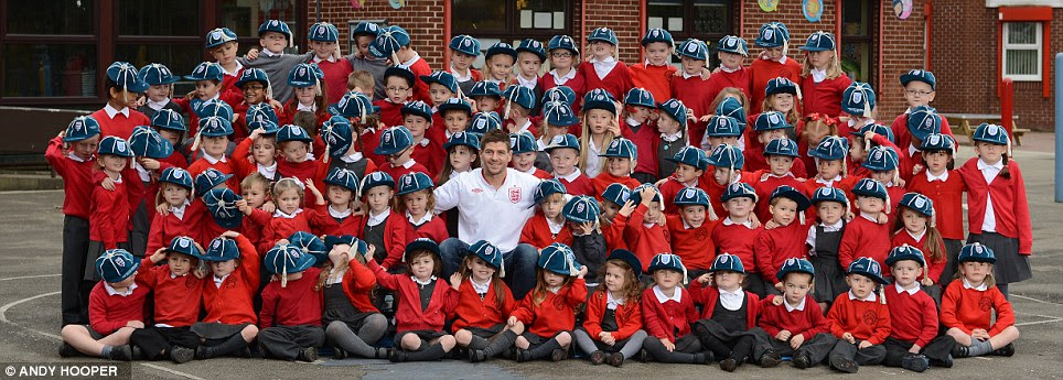 To cap it all: Gerrard with 99 pupils from his old school in Huyton