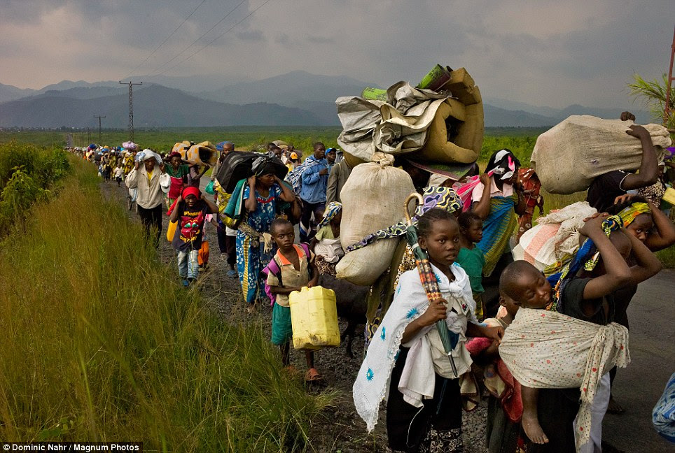 Refugees in their own land: Tens of thousands of internally displaced Congolese from Sake flee on a road linking Goma and Bukavu after escaping from clashes between M23 rebels and Congolese army soldiers in 2012