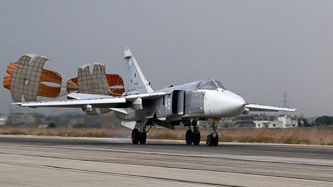 A Russian Sukhoi Su-24 bomber lands at the Russian Hmeimin military base in Latakia province, in the north-west of Syria (16 December 2015)