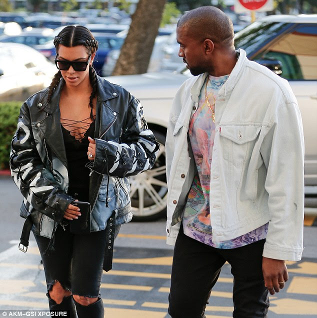 Her biggest fan: Kanye cast an admiring look at Kim as they headed into the theater