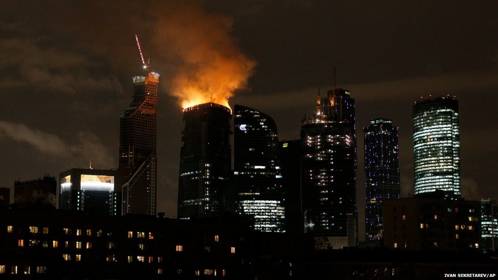 A fire engulfs the top of a Moscow skyscraper