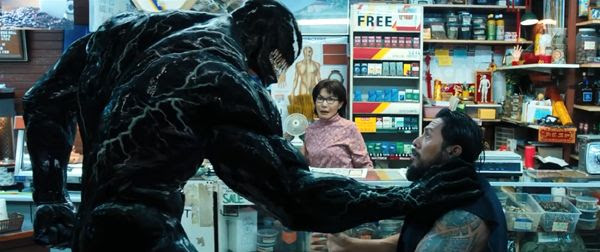 Venom confronts a thug inside a convenience store in VENOM.