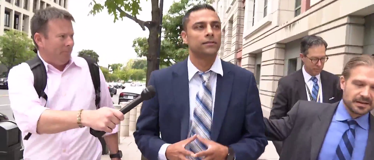 Imran Awan entering federal court for his arraignment Sept. 1, 2017. (Screenshot from One America News used with permission) | Imran Awan Explained On Fox News | Cops Accidentally Gave Evidence To Awan