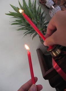 Putting candles on the Buddha shelf