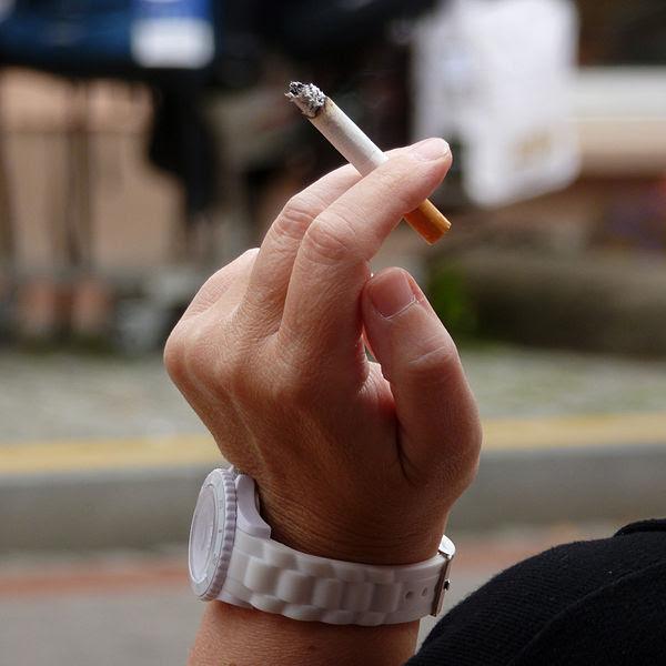 File:Woman smoking a cigarette.jpg