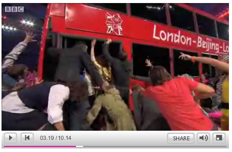 Scramble to get on bus - Olympic Handover -  BBC Screengrab
