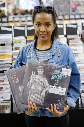 Keisha Adams, 18, from Chelmsford, poses with her Mac DeMarco albums; Salad Days and Mac DeMarco 2