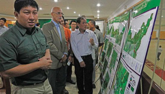 Jean-François Cautain (centre), European Union ambassador to Cambodia, attends the signing of a European Union-funded forestry project in Ratanakkiri