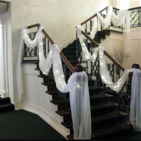 White draping and lights to decorate stairs #wedding