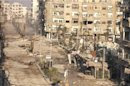 View of buildings damaged by missiles fired in Daraya
