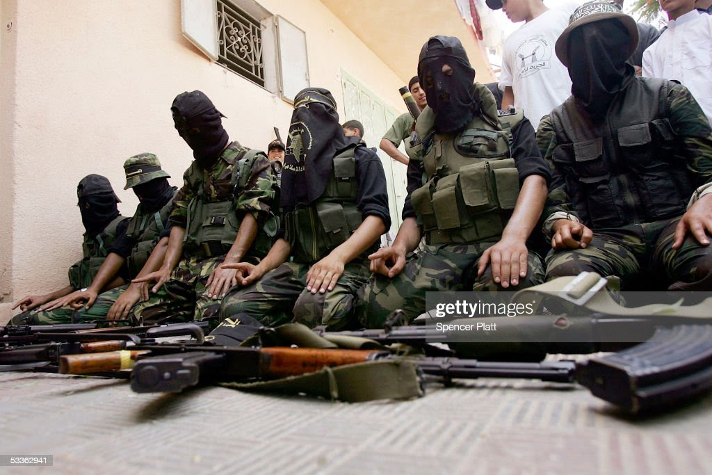 Members of the controversial Palestinian group Islamic Jihad display weapons while praying before walking through the streets in a march with supporters August 12, 2005 Gaza City, the Gaza Strip. As Israel prepares for a pullout of settlements in both Gaza and the West Bank, various Palestinian groups are vying for power in the post settlement Gaza.