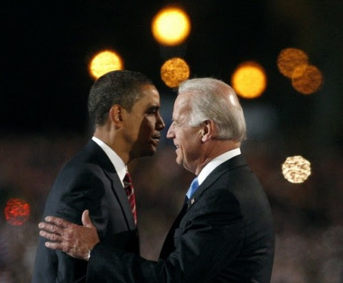 U.S. President-elect Senator Barack Obama (D-IL) and running mate Joe Biden (R) embrace following Obama's speech to supporters during his election night rally, after being declared the winner of the 2008 U.S. Presidential Campaign in Chicago, November 4, 2008.