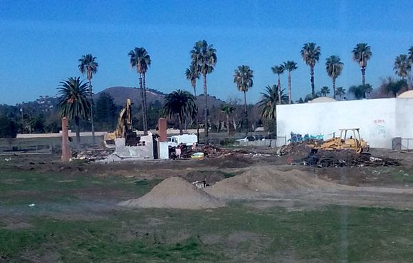 Only the two chimneys of the old abandoned house remain, as a demolition crew continues tearing down the structure on a vacant dirt lot behind my home in Pomona, CA...on January 26, 2018.