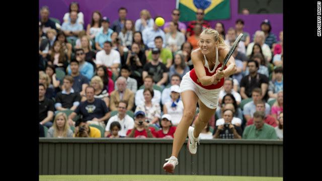 Russia's Maria Sharapova returns to Britain's Laura Robson during their women's singles tennis second-round match.