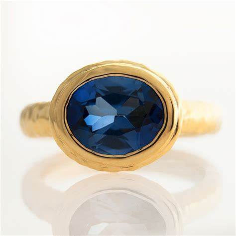J Briggs & Co Hammered Oval Bezel Ring Blue Sapphire