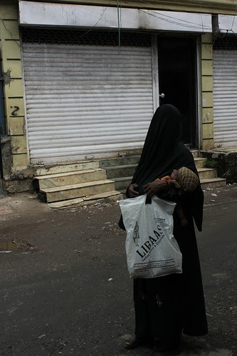 The Plastic Bag Says Libas ...Her Pain She Hid In a Mask by firoze shakir photographerno1