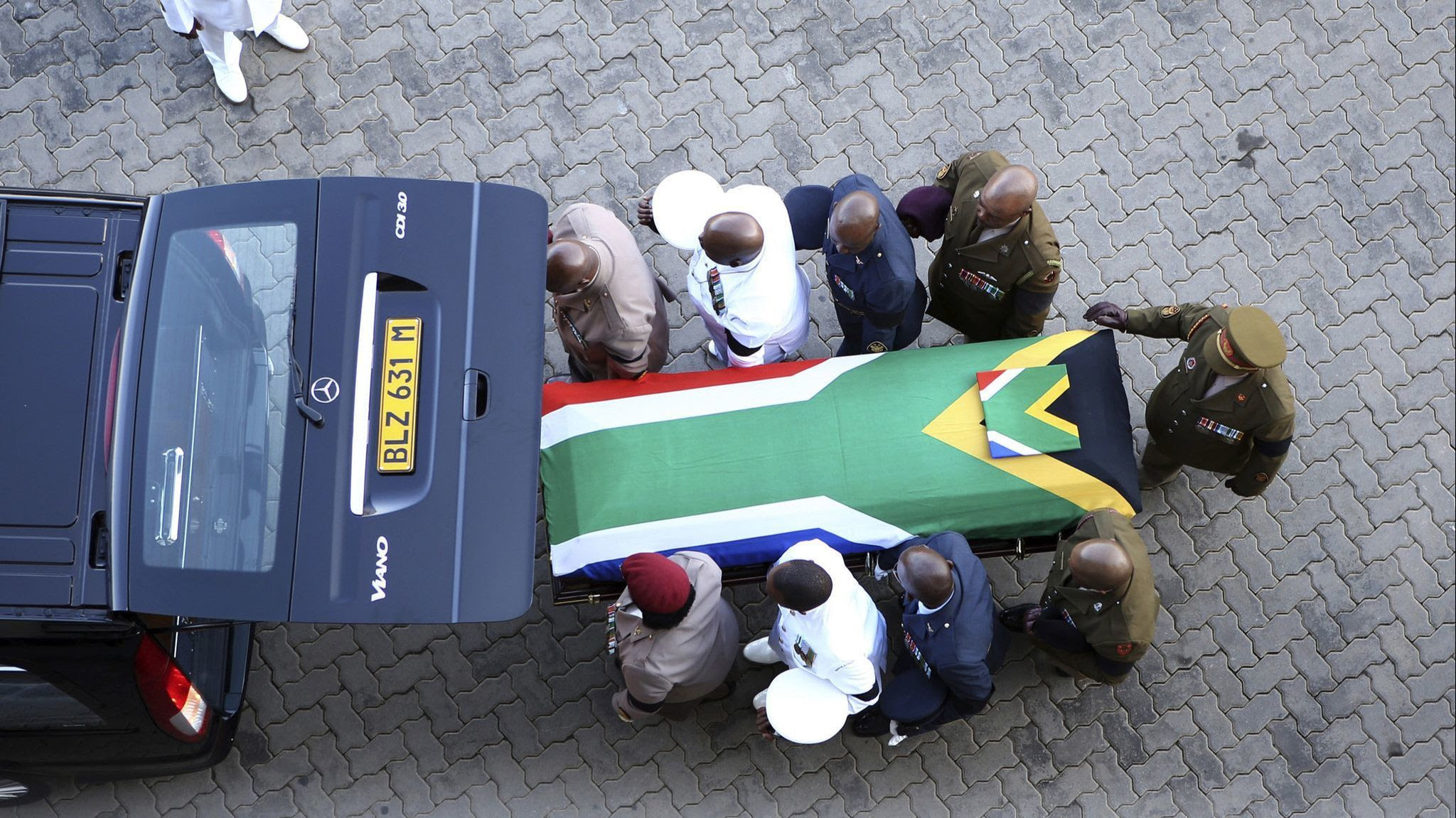 The flag-draped casket carrying the remains of struggle icon Winnie Madikizela-Mandela arrives at th