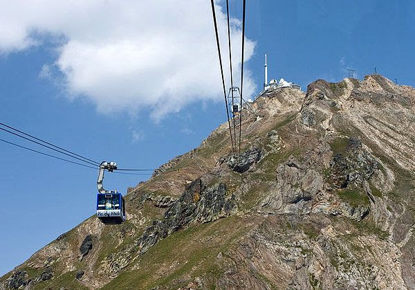 Cable cars approach the observatory atop Pic du Midi de Bigorre.