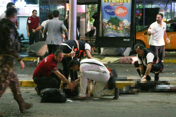 Paramedics attend to casualties injured outside Turkey's largest airport, Istanbul Ataturk