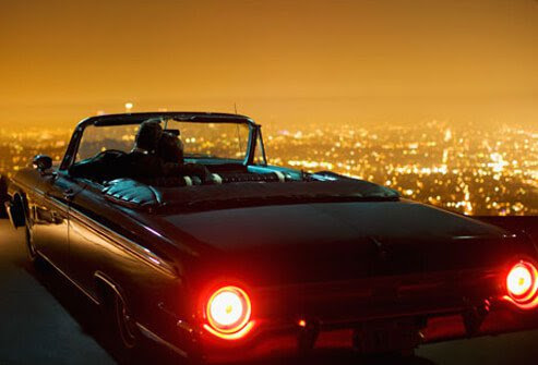 Photo of couple in a convertible.
