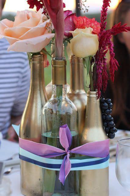 #centerpieces #DIY spray empty wine/liquor bottles with