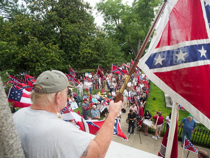 Wayne Morrison holds a confederate flag at Alabama