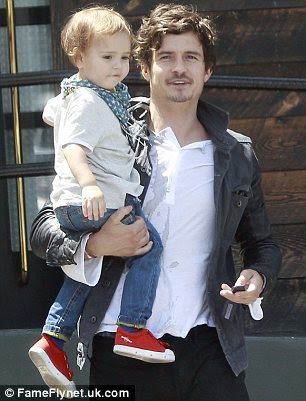 Boys weekend: Orlando Bloom looks after Flynn in LA while Miranda is in New York
