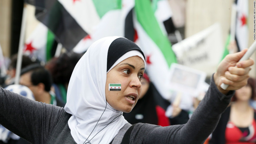 A woman participates in a demonstration in support of the Syrian people on July 7, 2012, in front of the Pantheon in Paris.