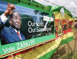 A Zimbabwe African National Union-Patriotic Front billboard calling for land and sovereignty. Mugabe won re-election on July 31, 2013. by Pan-African News Wire File Photos