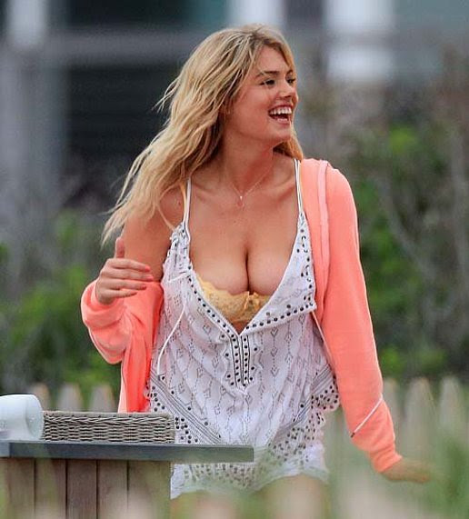 Kate Upton Shows Off Her Cleavage On Set
