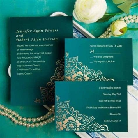 Beautiful emerald green and gold wedding invitations